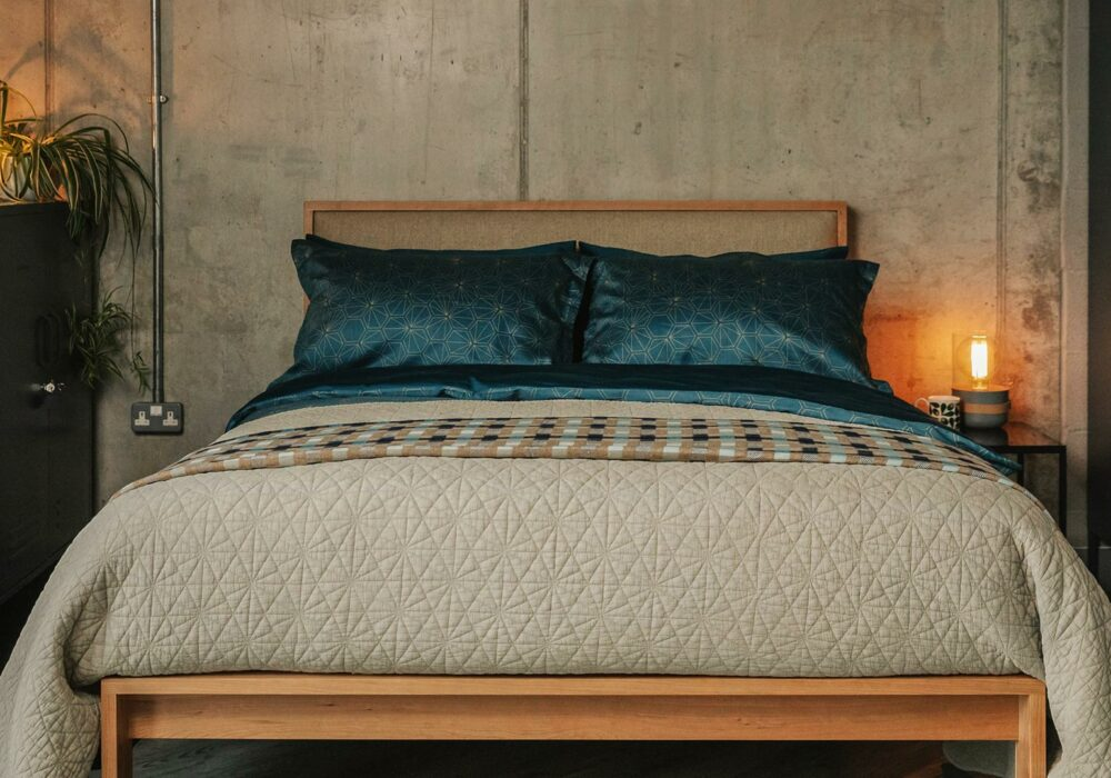 teal-hexagon-print-bedding-and-stone-quilt