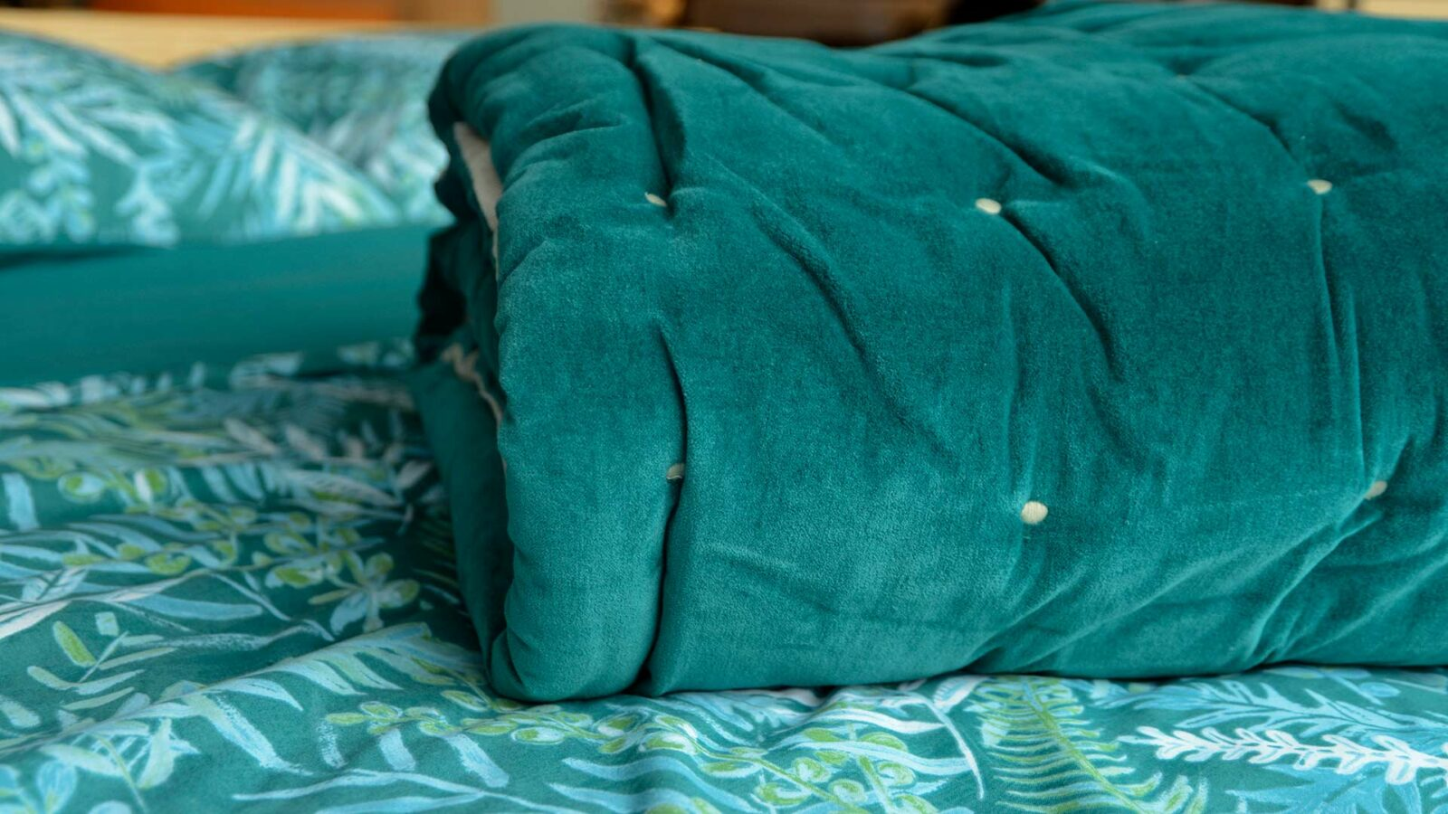 teal coloured velvet quilt with cotton fabric reverse