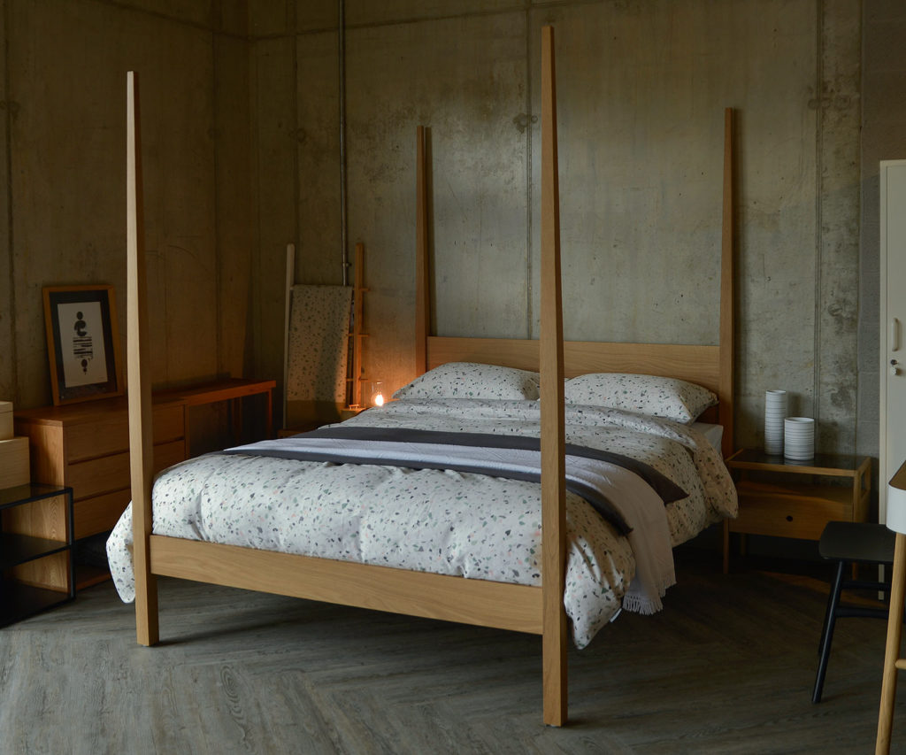 Hatfield is a solid wood hand-made wooden bed with 4 tall tapering posts