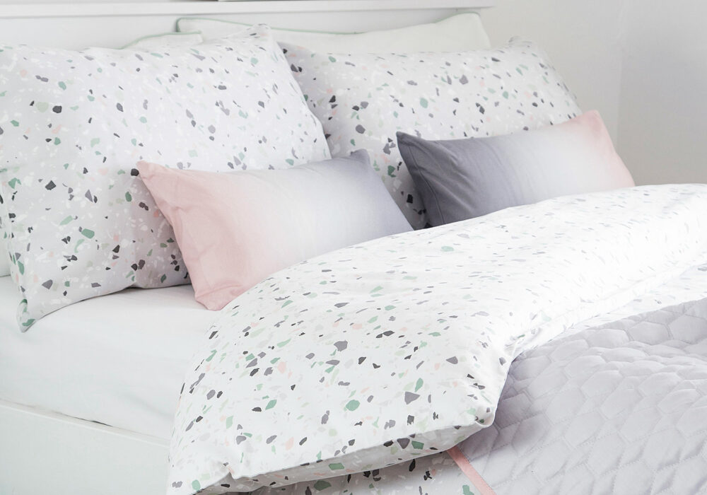 terrazzo print duvet cover set shown with ombre pink-grey cushions