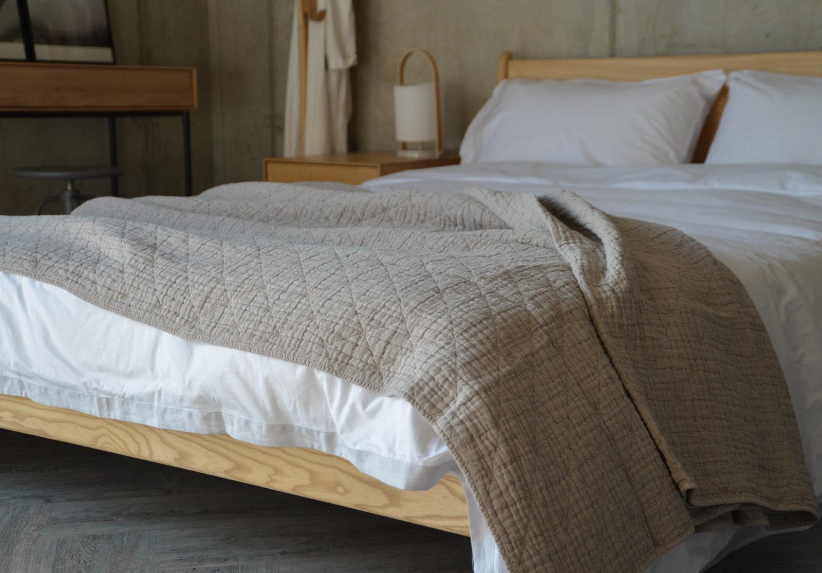 modern warm grey bedspread