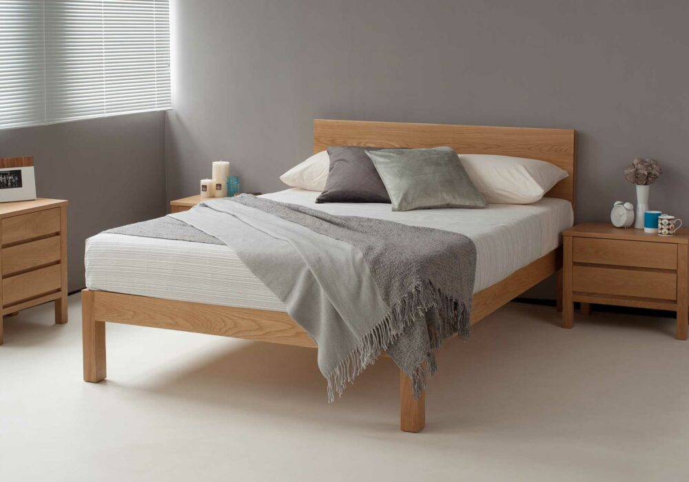 the Tibet is a chunky solid wood bedframe shown here Kingsize and in Oak