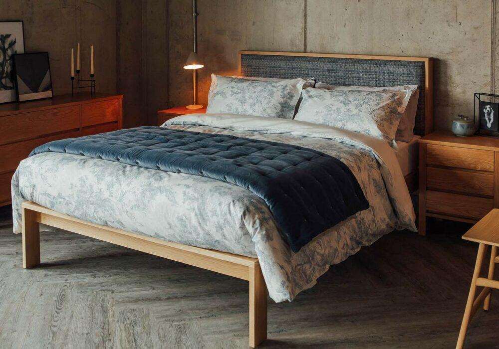 Modern traditional bedroom with wooden Shetland bed and oak Shaker bedroom storage furniture