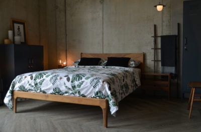 Our Hoxton wooden bed with Chevron headboard for a mid-century style bedroom