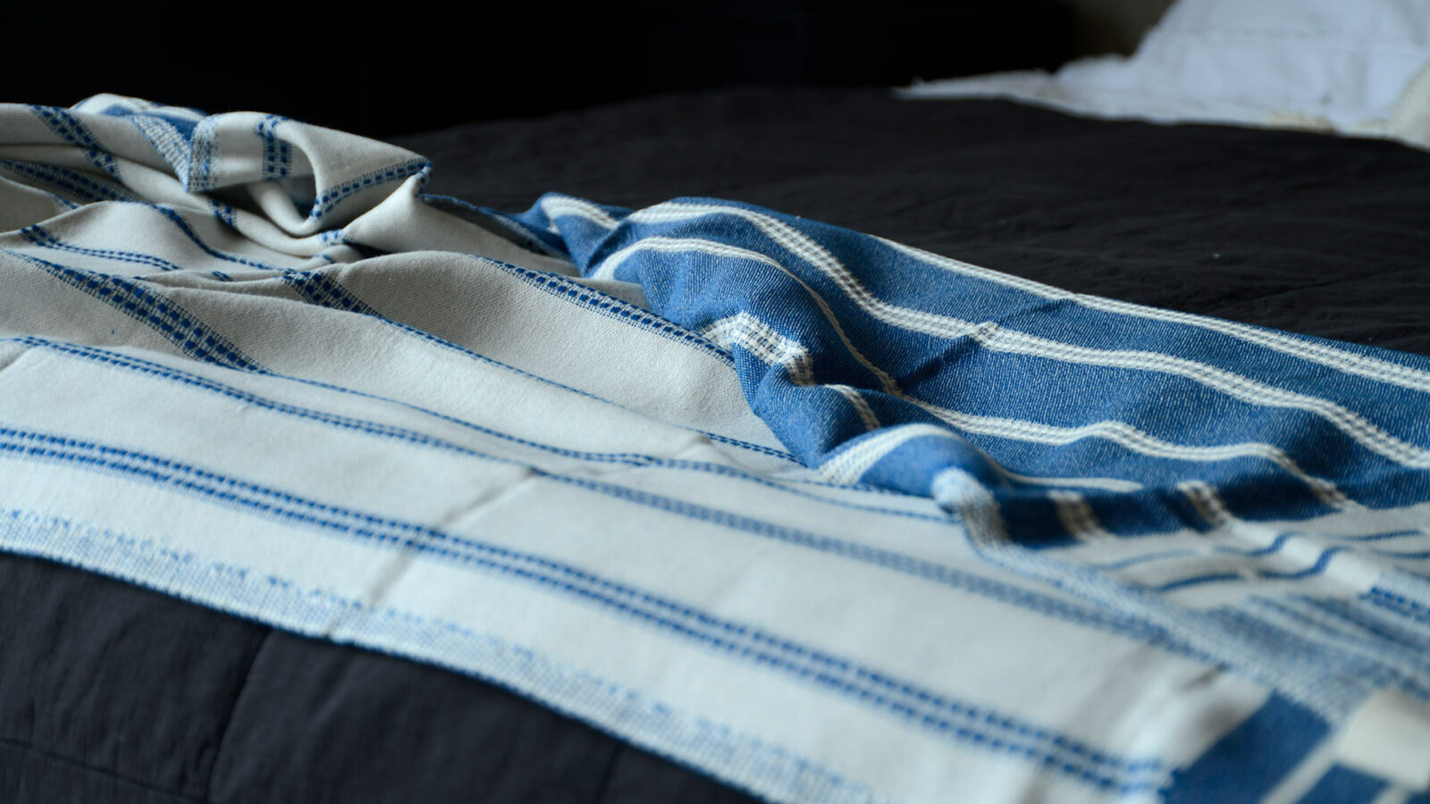 reversible blue and ivory coloured woven cotton throw