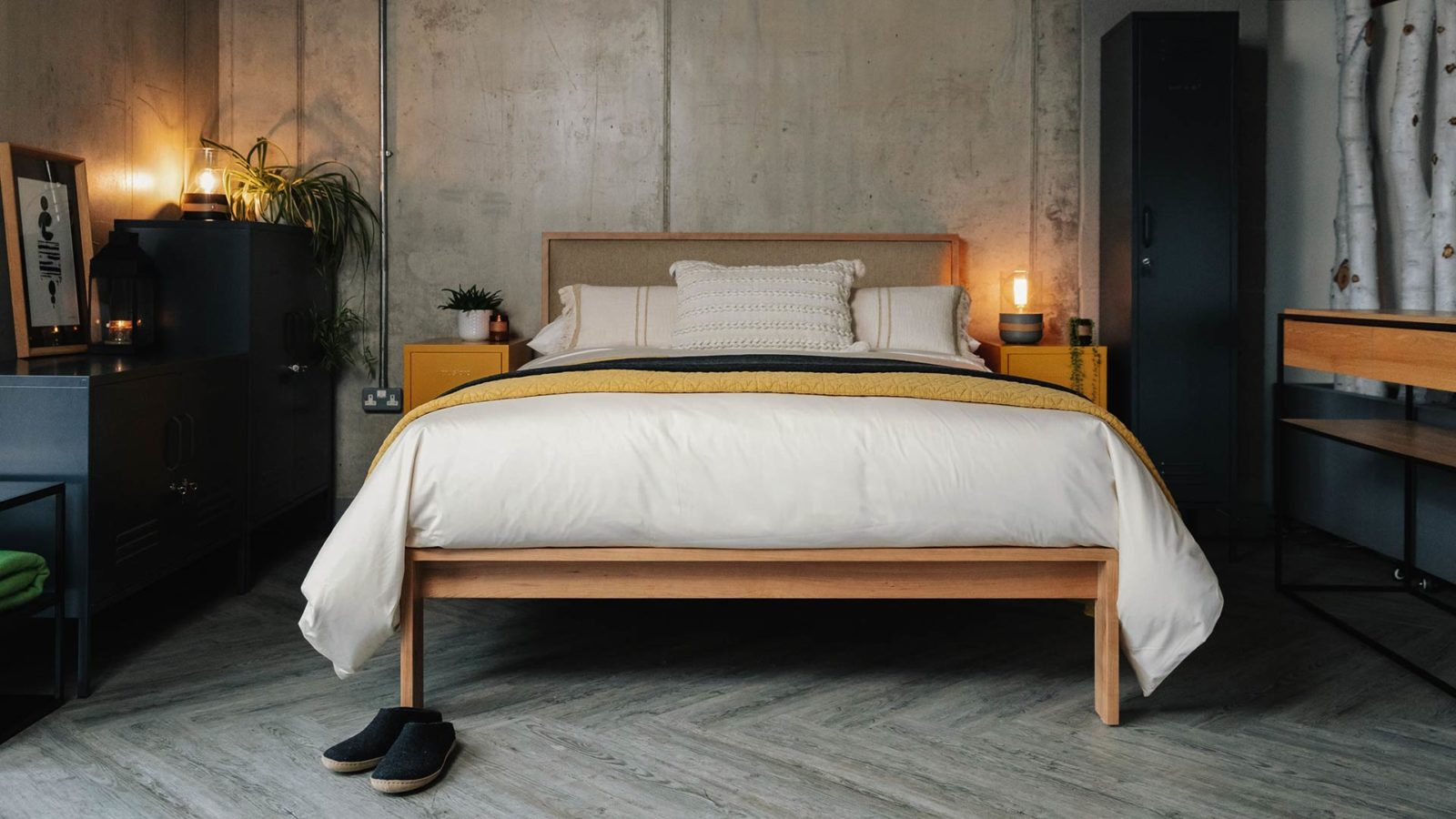 Industrial look bedroom featuring the Shetland taller wooden bed in cherry with wool fabric-covered padded headboard