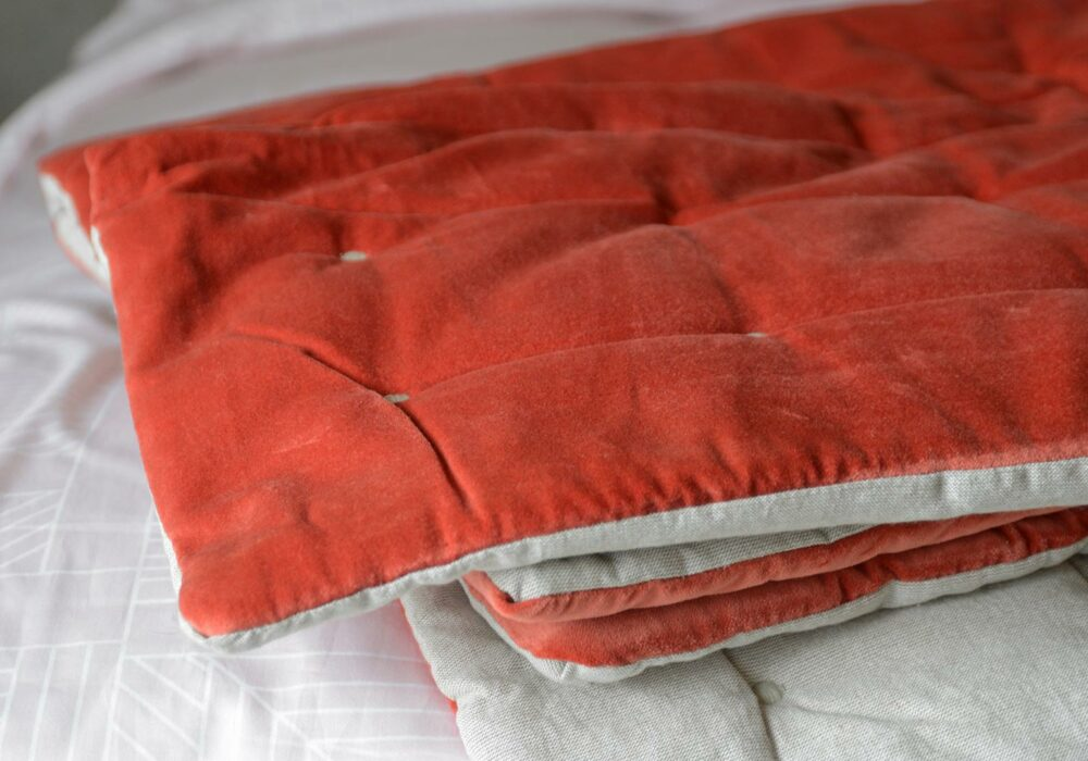 quilted cotton throw in coral velvet