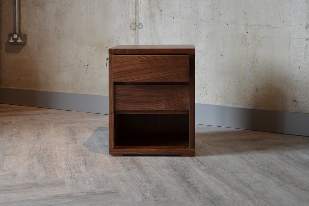Black Lotus Cube bedside table in Walnut, with 2 drawers and storage shelf. Exclusive to NBC.