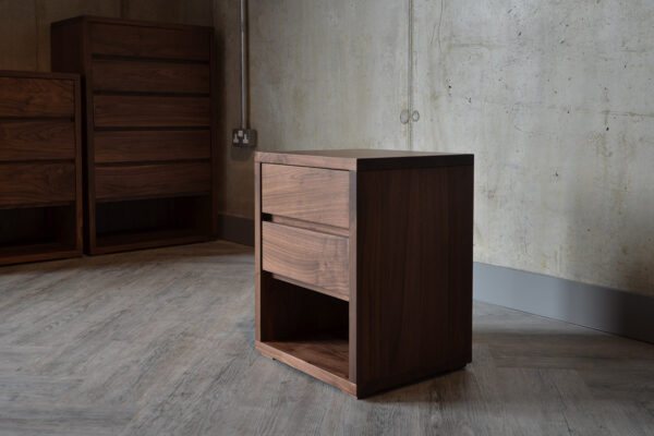 A side view of the Black Lotus 2 Drawer Cube Bedside Table in Walnut.
