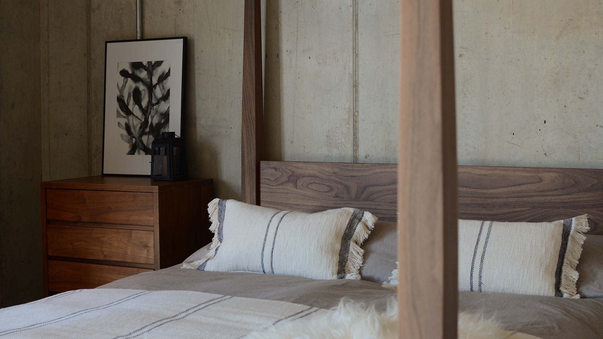 Walnut 4-poster Raj wooden bed shown with andas cotton throw and cushions