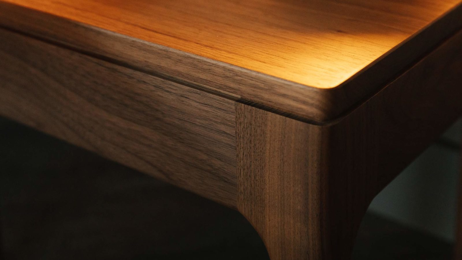 Detail view of our walnut solid wood hand made Camden table