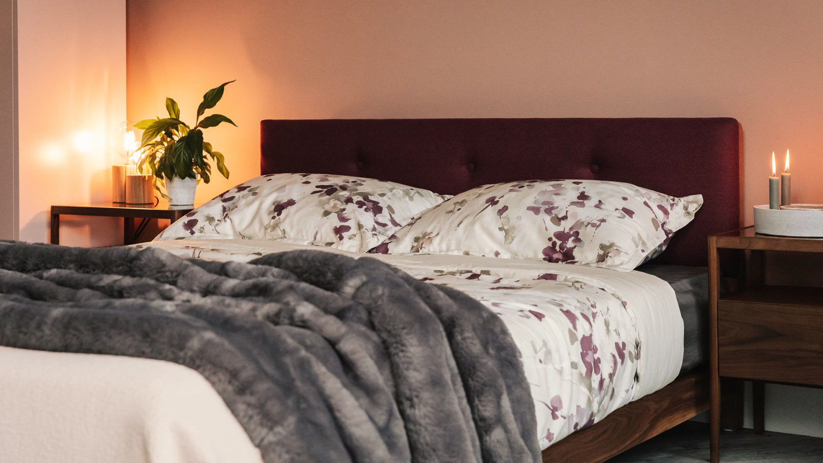 Iona a low wooden bed with upholstered and buttoned headboard. Great for low ceiling bedrooms