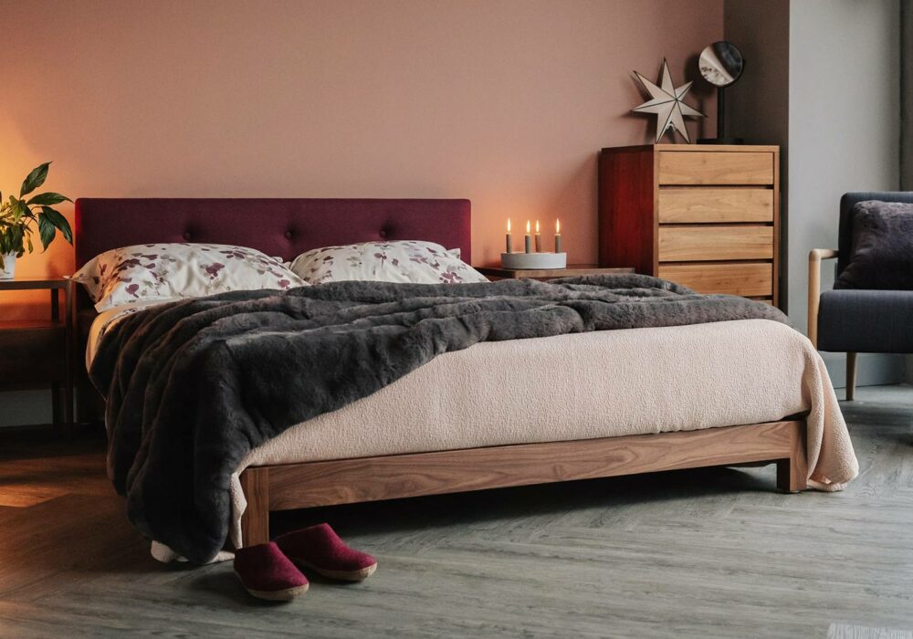 Walnut bed frame - our hand made Iona bed with upholstery in Amatheon Emperor wool fabric
