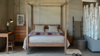 walnut Raj 4 poster with organic bedding and plum quilt