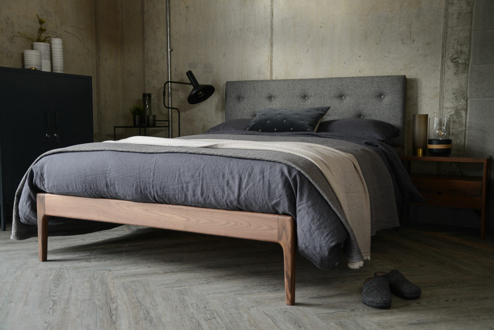 Scandinavian style bedroom featuring solid walnut framed Bloomsbury bed with grey upholstered headboard