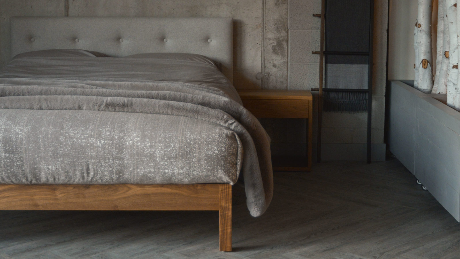 Walnut Arran bed with a buttoned upholstered headboard available in a choice of fabrics