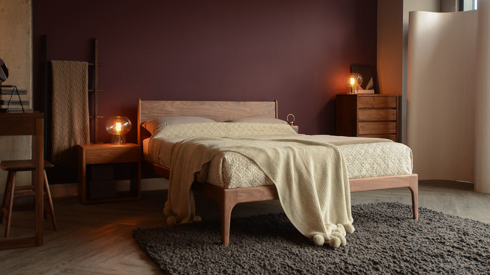 Hand made wooden Camden Bed in Walnut, with a matching walnut bedside and tall chest.