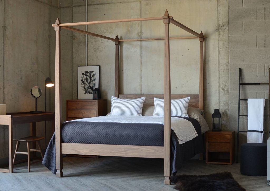 Our hand made Indian inspired Walnut four-poster Raj bed with black and white bedding