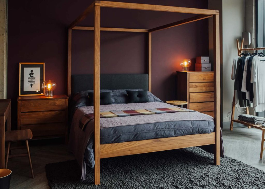 Cosy Winter bedroom featuring the solid wood Highland 4 poster bed in Walnut and walnut shaker drawers