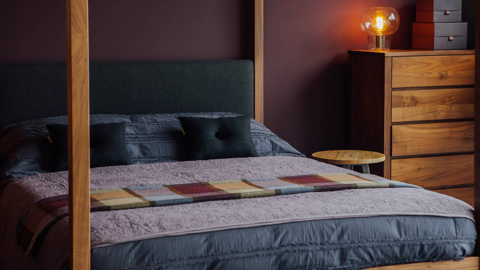 Contemporary 4 poster Highland bed with walnut bed frame and wool upholstered headboard
