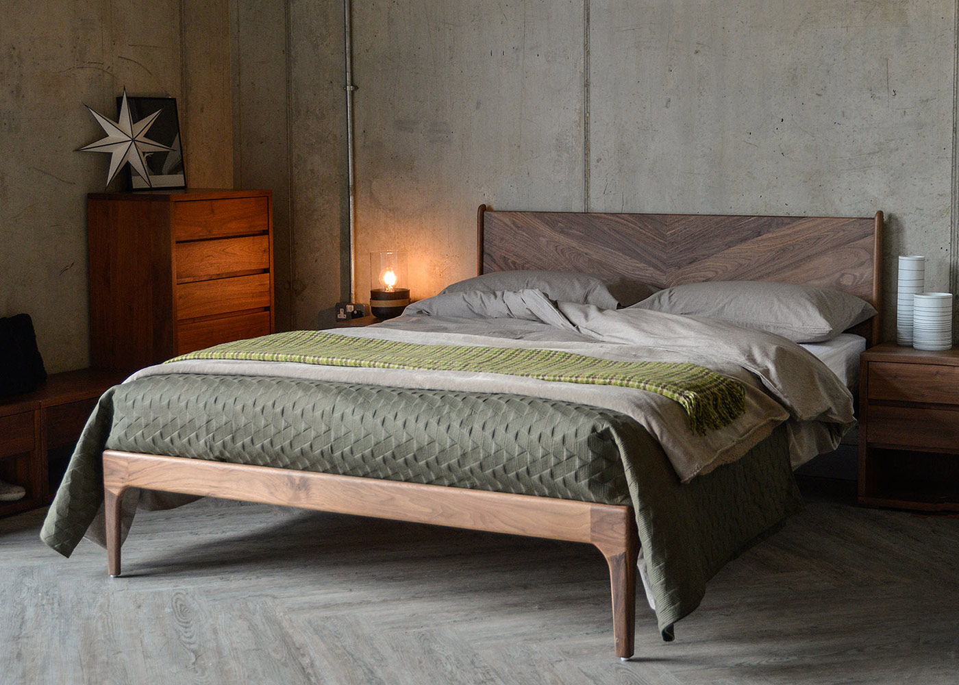 Mid-century style hand made Hoxton bed with its Chevron headboard shown in rich Walnut wood.