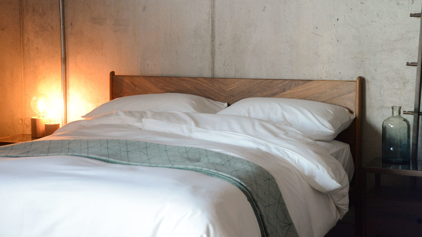 ivory organic cotton bedding shown on Hoxton bed with hand made solid wood herringbone headboard.