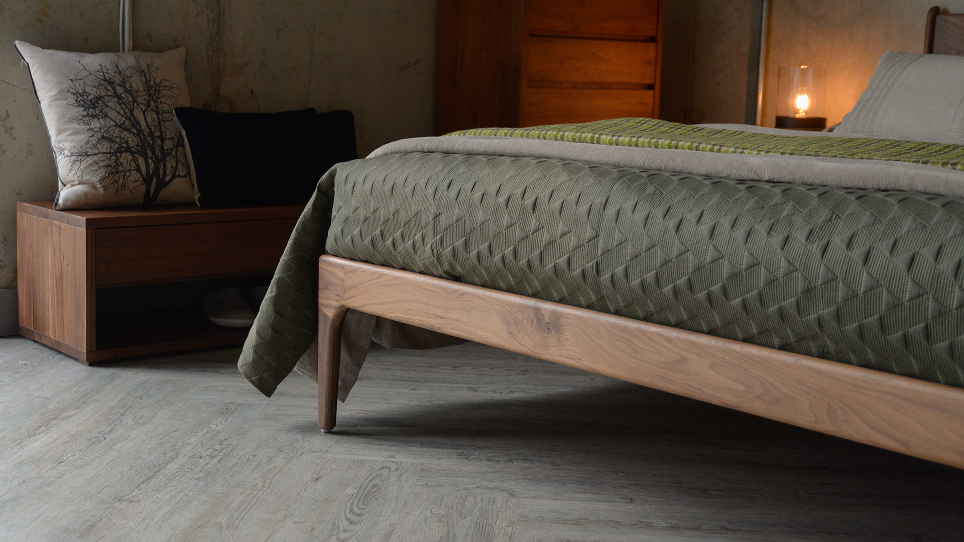 A closer view of the wooden Hoxton Bed leg made from Walnut wood.