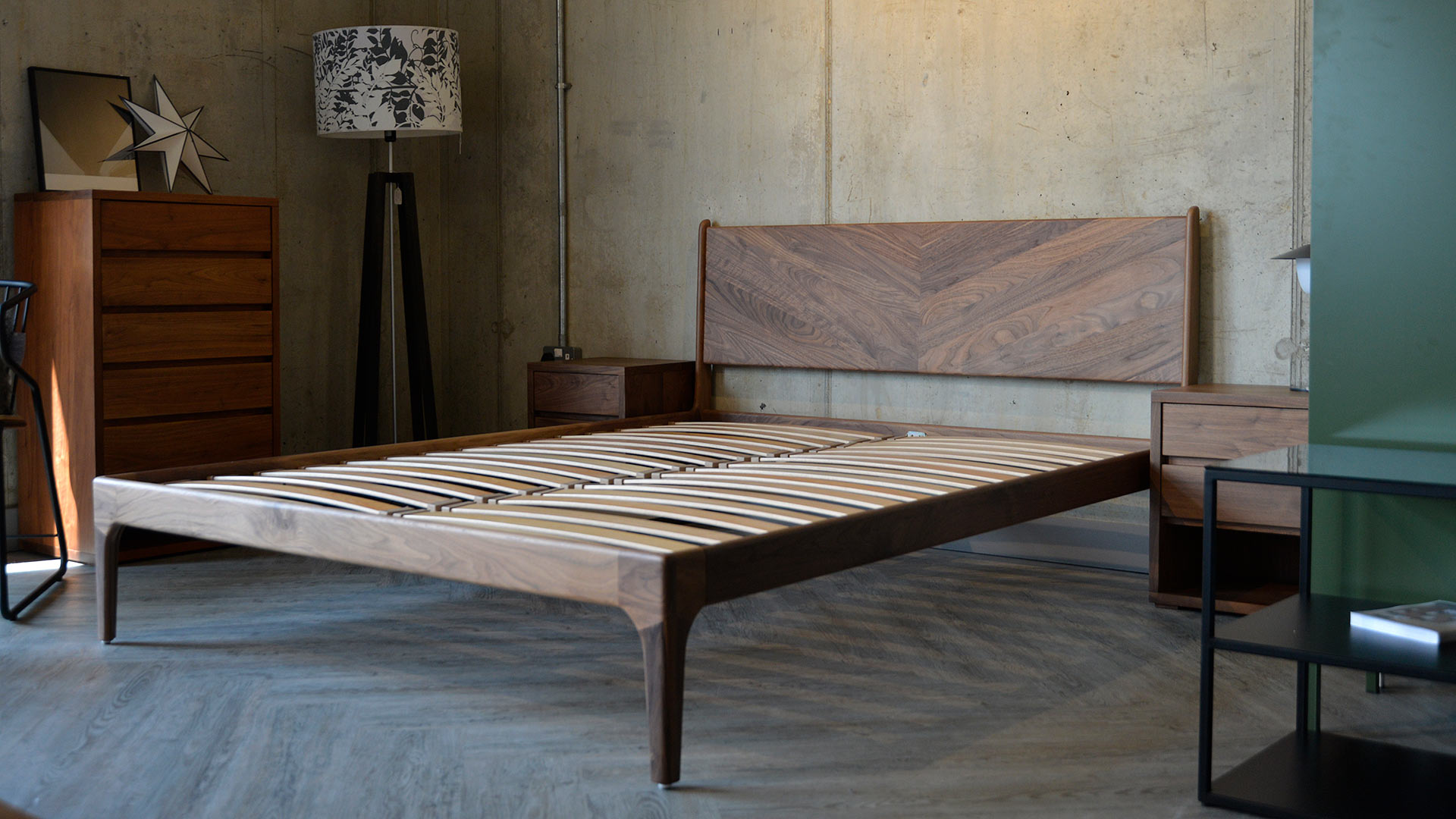 Our hand-made mid-century style wooden bedframe the Hoxton Bed with Chevron headboard, shown in Walnut.