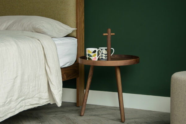 walnut wood tray table with handle used as bedside table