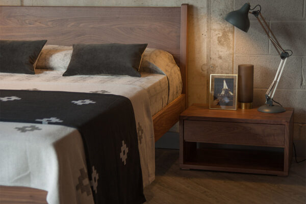Low 1 drawer Cube bedside table shown with Zanskar wooden bed, all in Walnut wood.