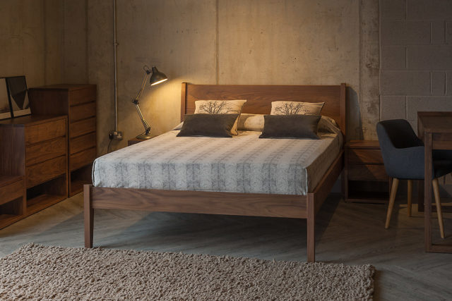 Walnut wooden Zanskar bed with Cube bedroom furniture to match.