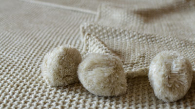 Biscuit Pom Pom Knitted Throw