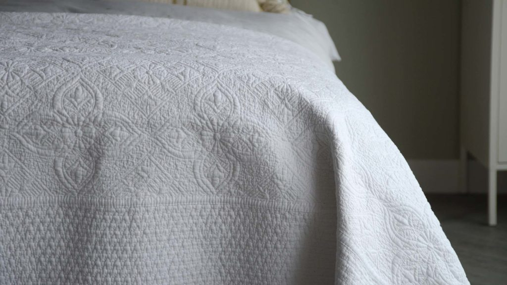embroidered white bedspread