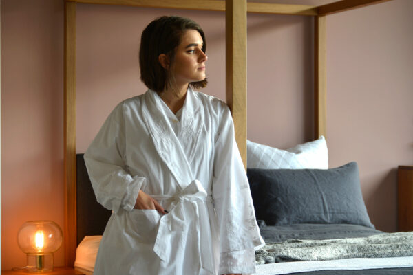 traditional white cotton dressing gown with embroidered lapels cuffs and hems