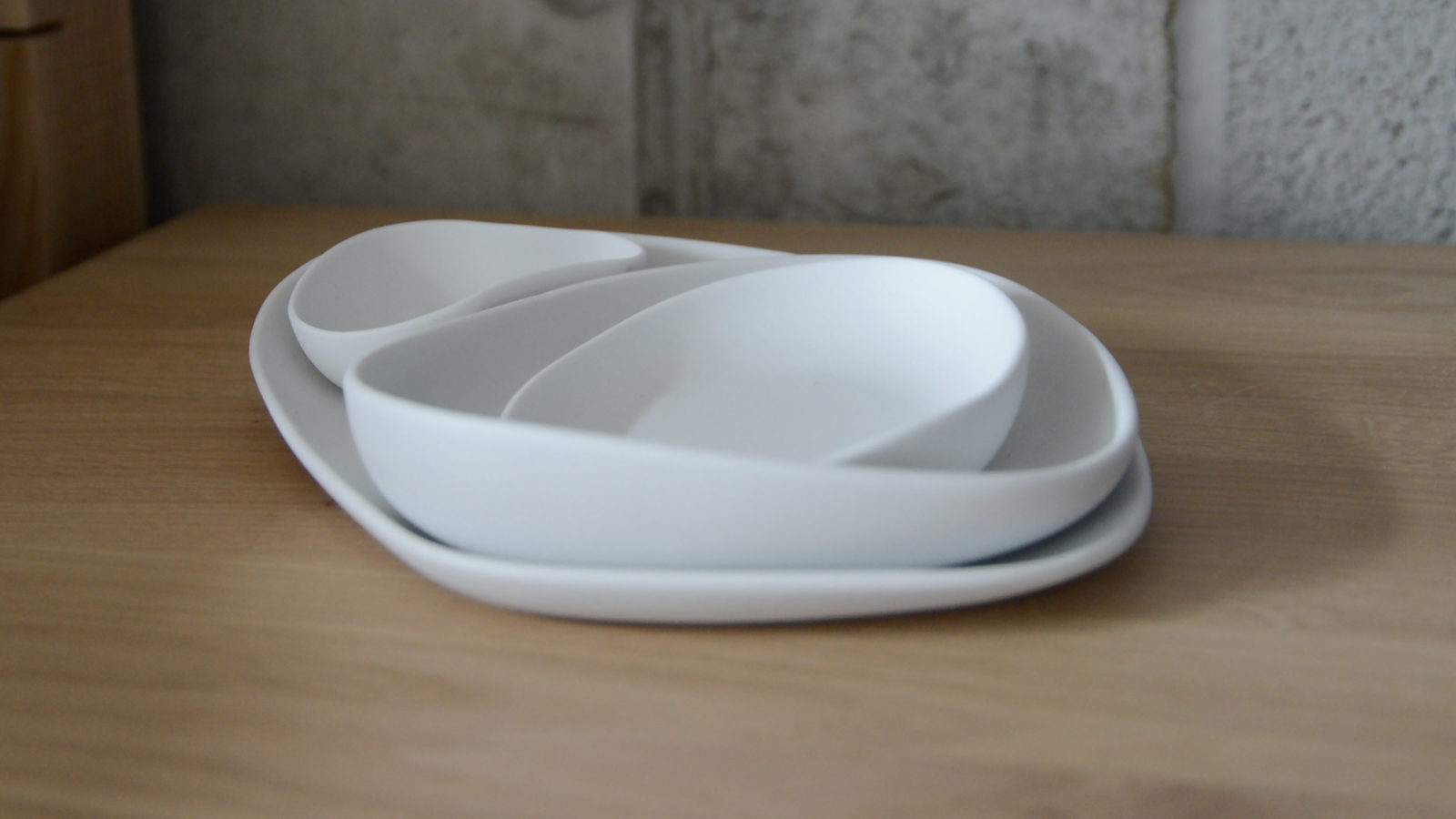 modern irregular shaped dishes set in matt white