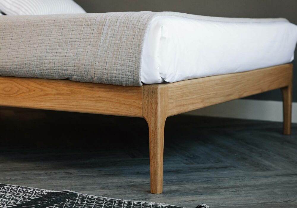 Bloomsbury bed has a hand crafted solid wood frame with curving legs
