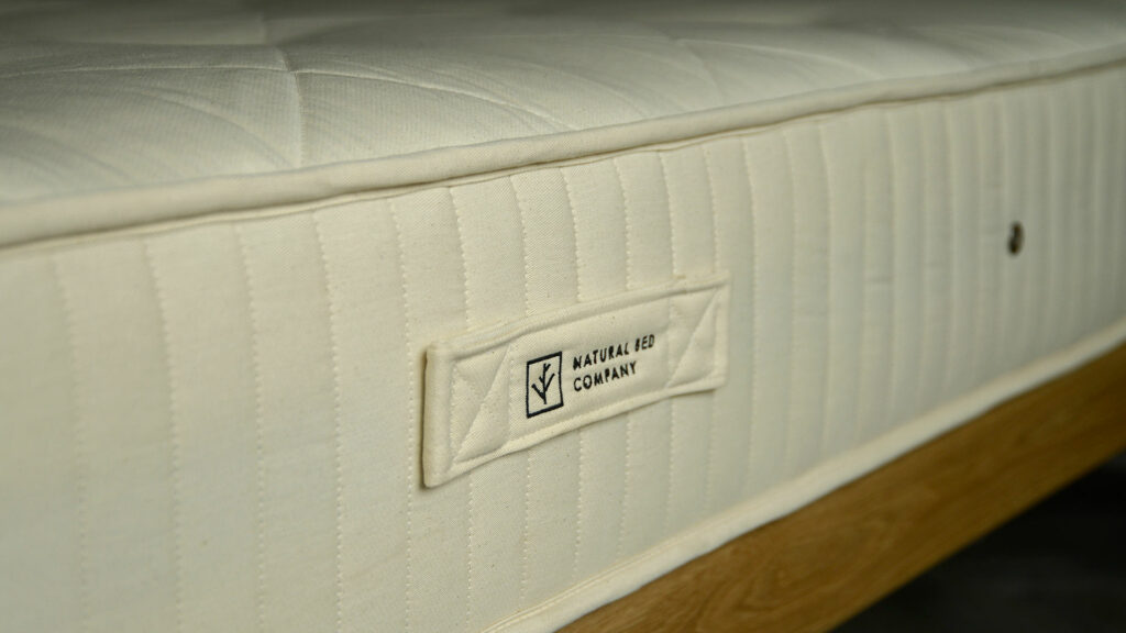 100% natural and biodegradable mattress made from latex and coconut fibres with an outer layer of wool