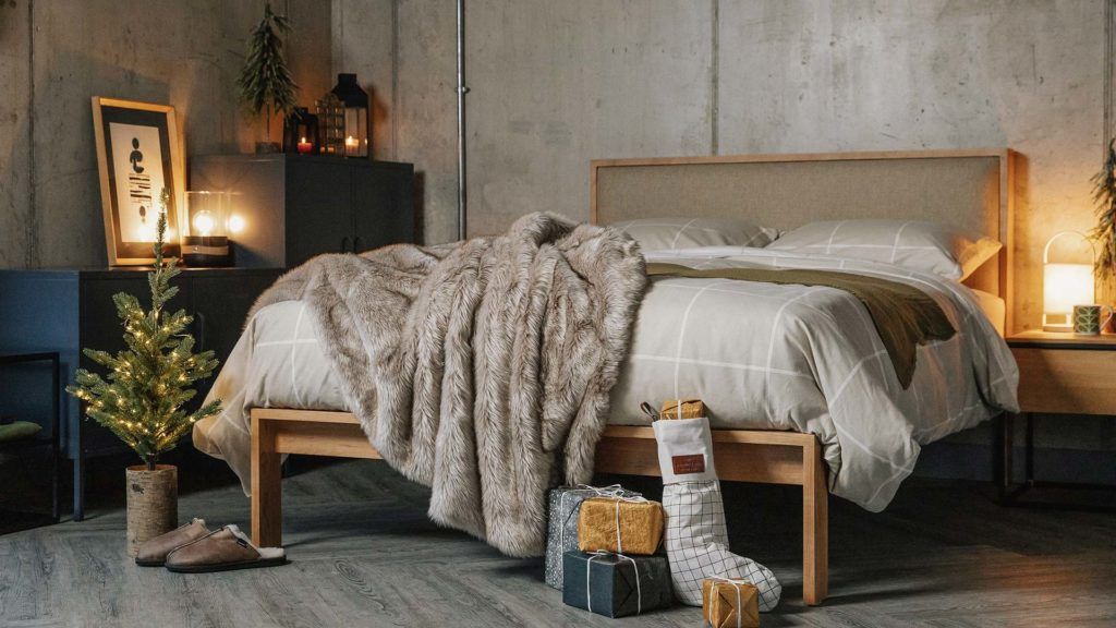 Contemporary Scandi Christmas bedroom, Shetland wooden bed with brushed cotton bedding in beige and ivory