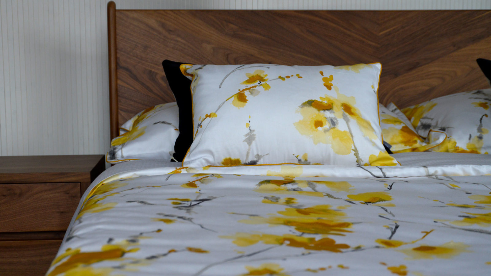 yellow-and-ochre-flower-print-cushions-and-bedding