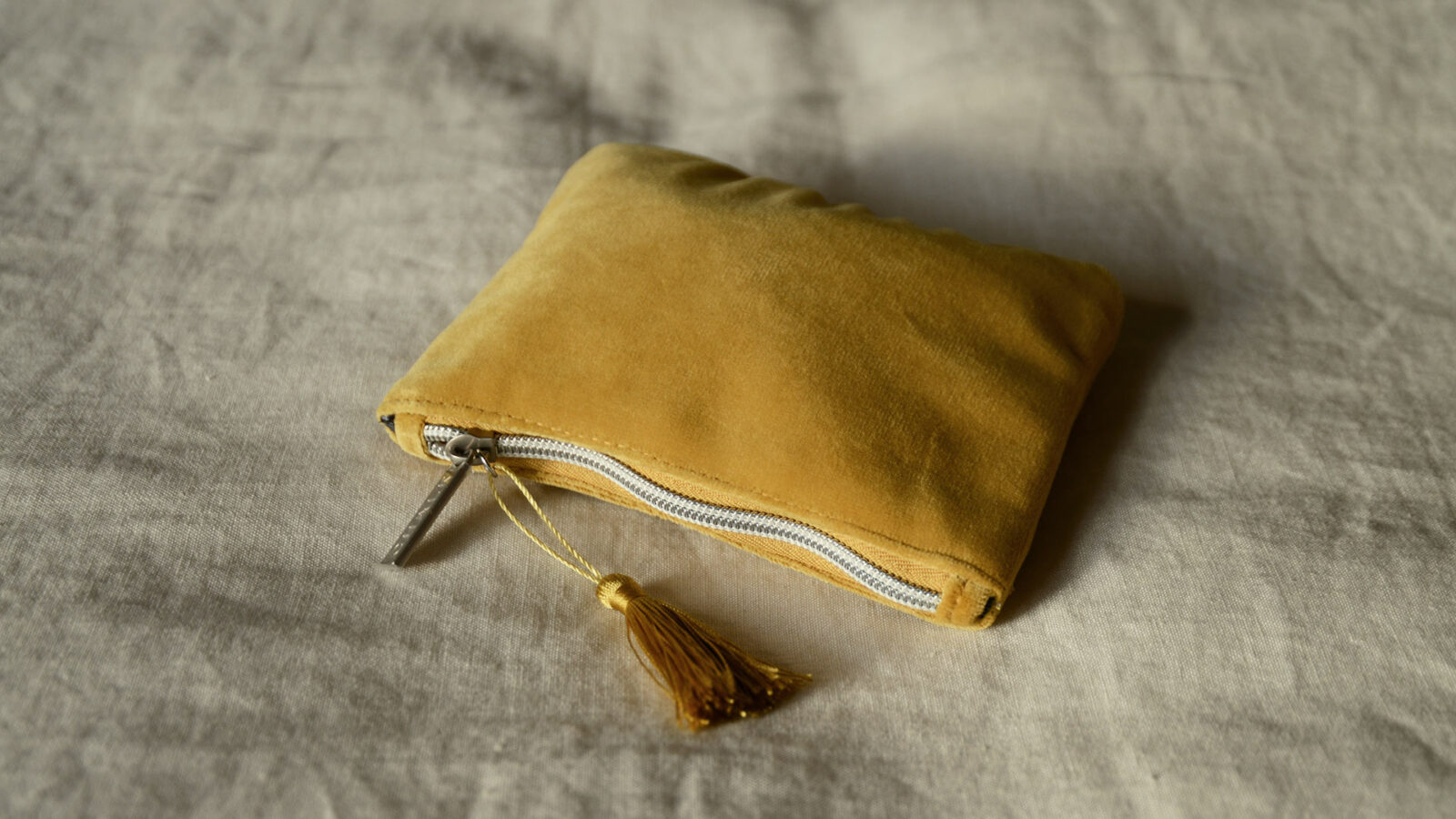 Velvet zipped pouch in mustard yellow